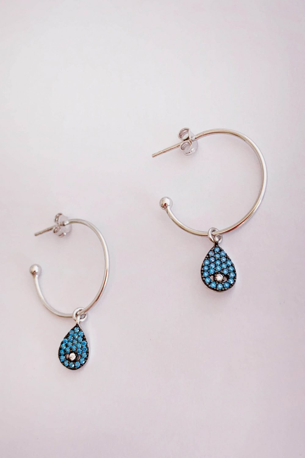 Earrings by Dora Syrrou